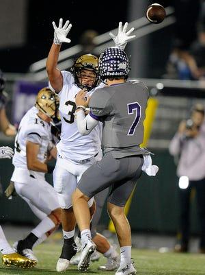 Abilene High linebacker AJ Gonzales (32) pressures Keller Timber Creek quarterback Cade Schrader (7) during the second quarter of the Eagles' 56-31 win on Thursday, Nov. 3, 2016, at Keller Athletic Complex.