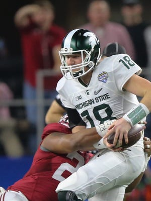 Michigan State QB Connor Cook is sacked by Alabama's Ryan Anderson during first half Thursday in Arlington, Texas.