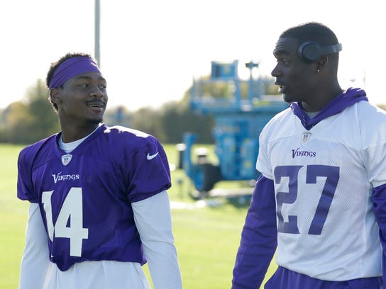 Minnesota Vikings wide receiver Stefon Diggs, 14, and safety Jayron Kearse, 27, walk off the field after taking part in an NFL training session at the London Irish rugby team training ground in the Sunbury-onThames suburb of south west London, Friday, Oct. 27, 2017. The Minnesota Vikings are preparing for an NFL regular season game against the Cleveland Browns in London on Sunday. (AP Photo/Matt Dunham)