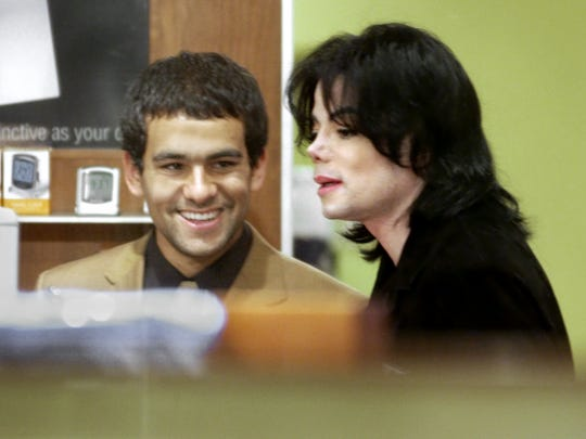 Michael Jackson was the main attraction at the Circle Centre Mall again, as he did a little personal shopping at Brookstone with his entourage while also being followed by a gigantic mob of fans on June 9, 2003.