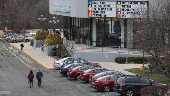 Moviegoers enter the Saw Mill Multiplex Cinema in Hawthorne. The theater will close Jan. 18 to make way for a new Audi dealership, but it might be months before construction work begins.
