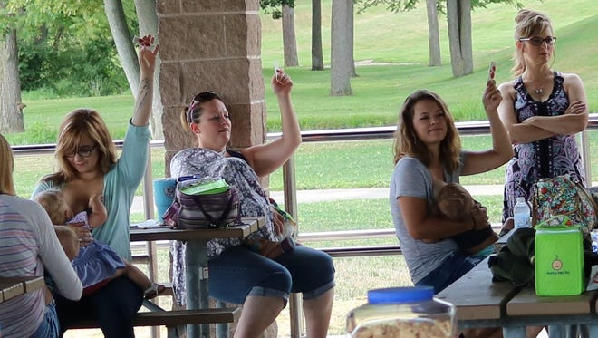 Twenty moms from throughout Sandusky County participated in the local 'Big Latch On' event in Clyde on Saturday. More than 50 supporters attended.