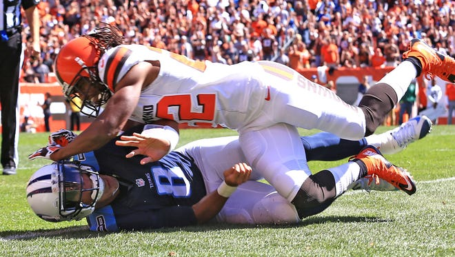 The Browns roughed up Titans rookie quarterback Marcus Mariota, sacking him seven times and leaving him with a sore ankle.