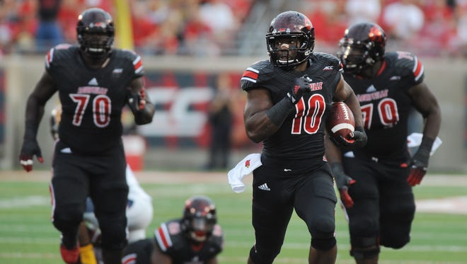 UofL's Dominique Brown (10) runs on a big gain against Murray State on Saturday at Papa John's Cardinal Stadium. (By David Lee Hartlage, Special to the C-J) Sept. 6, 2014.