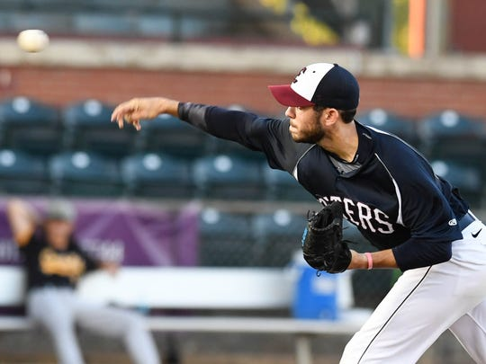 Otters pitcher Matt Wivinis throws in the first inning as the Evansville Otters play the Normal CornBelters at Bosse Field Wednesday, August 24, 2016.