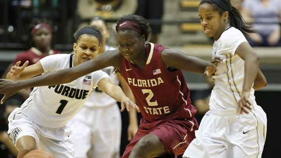 Ashley Morrissette, left, and April Wilson battle Adut Bulgak of Florida State for a loose ball in the ACC/Big Ten Challenge Wednesday, December 3, 2014, at Mackey Arena. Purdue lost to FSU 67-64 in overtime.