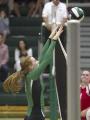 Fort Myers player Kaitlin Stewart blocks a spike from