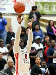 West Oso's Daniel Roberson shoots against Brazosport during the Regional IV-4A finals on Saturday, March 4, 2017, at the Steinke Physical Education Center in Kingsville.