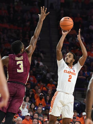 Clemson guard Marcquise Reed (2) shoots a three point shot over Florida State guard Trent Forrest (3) during the 1st half on Wednesday, February 28,  2018 at Clemson's Littlejohn Coliseum.