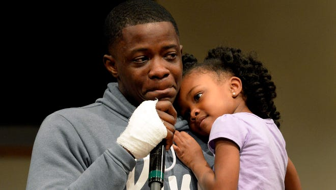 James Shaw Jr. holds his daughter, Brooklyn Shaw, 4, as he cries while speaking during a prayer vigil Monday, April 23, 2018, at Mount Zion Baptist Church in Antioch. Hundreds of civic leaders and residents attended the vigil for those affected by the Waffle House shooting.