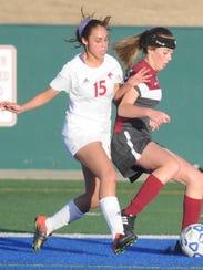 Cooper's Alexandria Rodriguez, left, battles a Midland