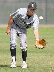Basha center fielder Ryan Tierney and some of his teammates