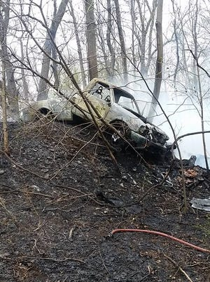 A pickup truck caught fire Friday after the driver crashed it into an embankment.