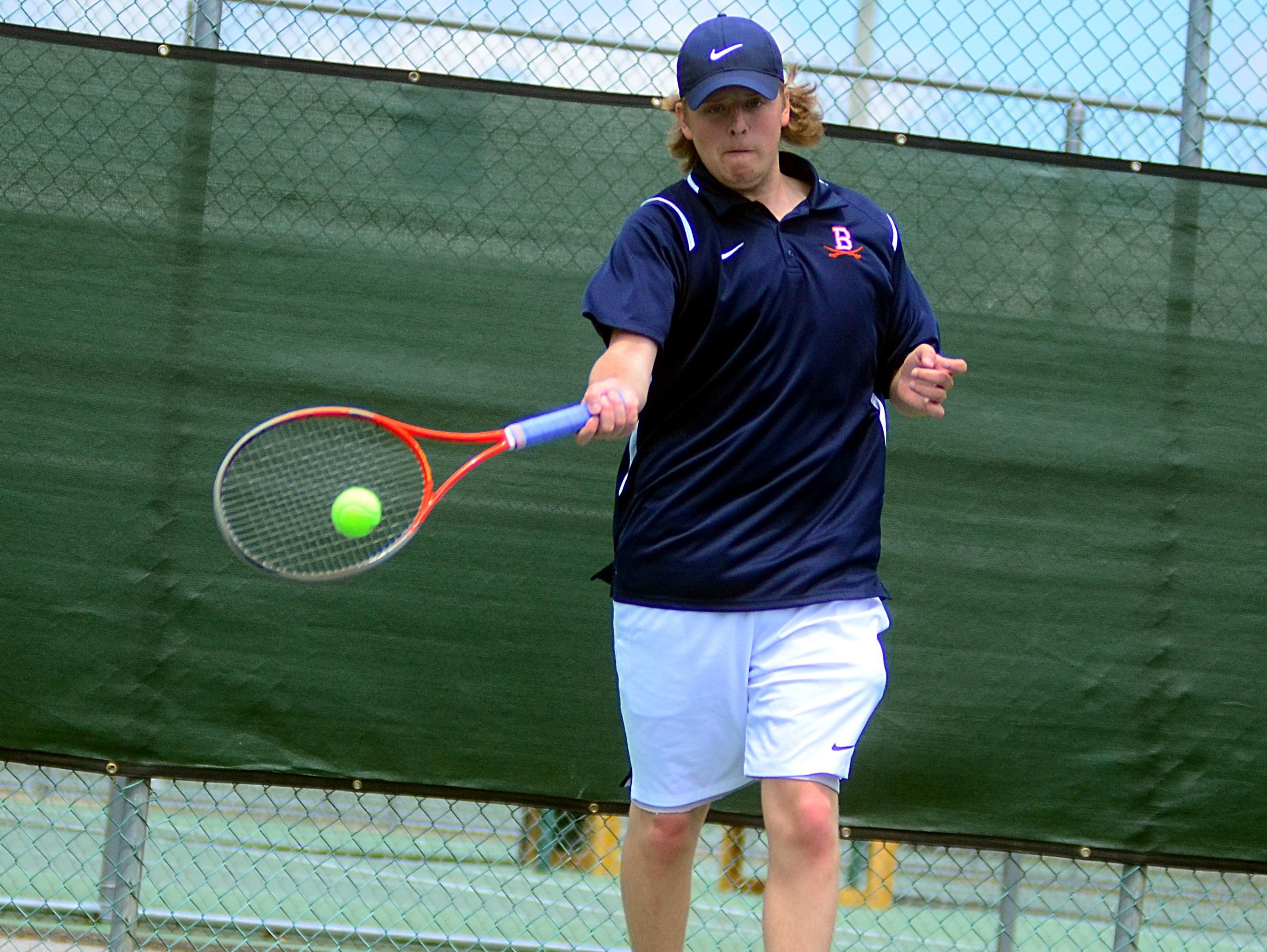 Beech High senior Eli Duncan hits a forehand during his first-round singles match on Tuesday at the District 9-AAA Individual Tennis Tournament. Duncan advanced to the quarterfinals before suffering a straight-set loss to Wilson Central's Michael Mercante.