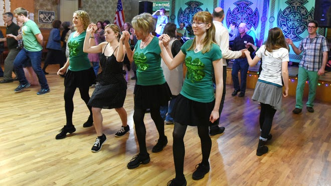 Stacey Brown (left), Crystal LeFebvre, Daryla Haven and Danica Galindo display their Irish dancing skills with the Céilí of the Valley Society at the VFW Hall.