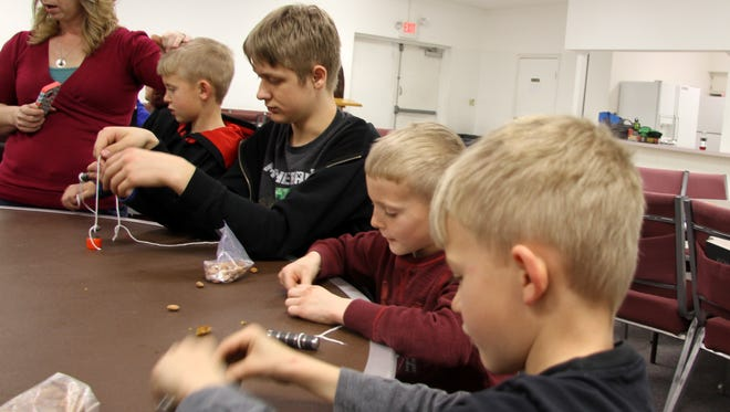 Home schooled students (from left to right) Ty Corbin, Shiloh Wyatt, Kale Corbin and Kade Wyatt observed the effects of magnets on compasses at  Sunset Church of Christ on Friday.