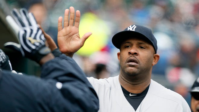 New York Yankees' CC Sabathia is congratulated in the dugout after being pulled from a baseball game against the Detroit Tigers during the seventh inning Saturday, April 9, 2016, in Detroit.