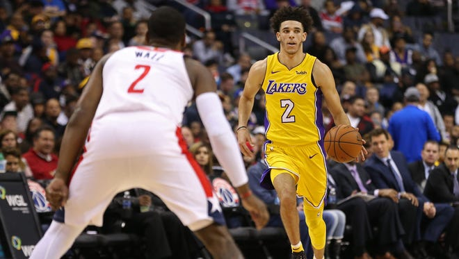 Los Angeles Lakers guard Lonzo Ball (2) dribbles the ball as Washington Wizards guard John Wall (2) defends in the third quarter at Capital One Arena.