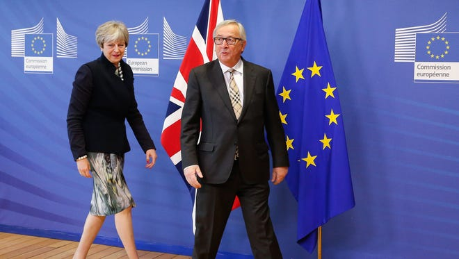 British Prime Minister Theresa May is welcomed by EU Commission President Jean-Claude Juncker prior to a meeting at the EU Commission in Brussels, Belgium, on Dec. 4, 2017.
