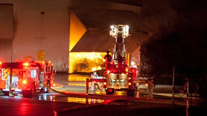Lafayette firefighters battle a fire inside a building at Best Way Disposal in Lafayette. The fire inside the building was so intense that firefighters could only fight it from outside for more than an hour.Steven Porter/Journal & Courier
