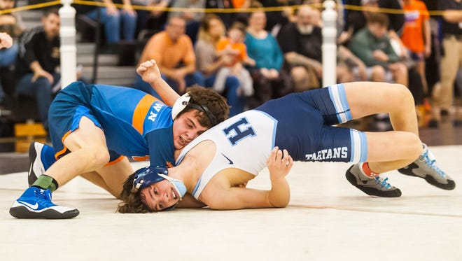 Woodstown's Jack Prendergast, who had a bye a year ago at regions and wrestled in pre-quartefinals this year, works against Highland's Brody Colbert at 120 pounds in the Region 8 opener on Wednesday night at Egg Harbor Twp.