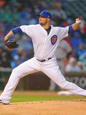 Cubs starting pitcher Jon Lester delivers a pitch during
