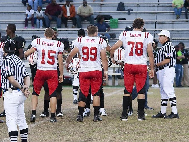 Leon alum Trey Braun (78) towers above his teammates during a coin toss against Lincoln in 2010. Braun is now a starting offensive lineman for Georgia Tech.