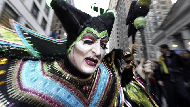Nick Magenta, captain of the Polish American String Band, is the character Maleficent on Broad St. during the 2017 Mummers Parade in Philadelphia., on Sunday, Jan. 1, 2017. (Elizabeth Robertson/The Philadelphia Inquirer via AP)