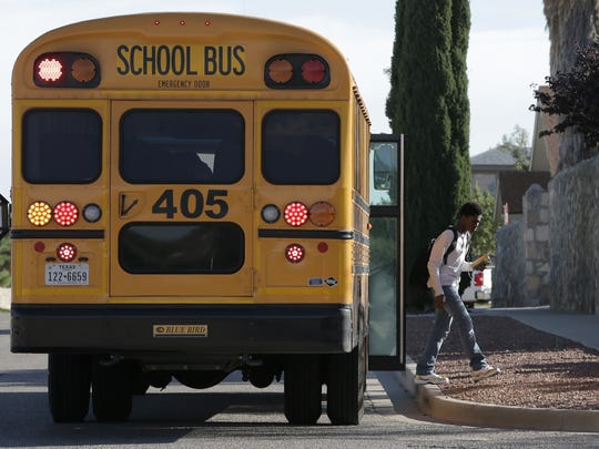 An Andress High School student gets off the bus in the North Hills neighborhood. EPISD had planned a high school in the area to serve the growing Northeast population.