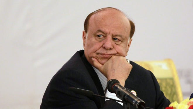 Yemen's President Abdrabuh Mansur Hadi listening during the second national dialogue conference in the Yemeni capital, Sanaa on June 6, 2013.