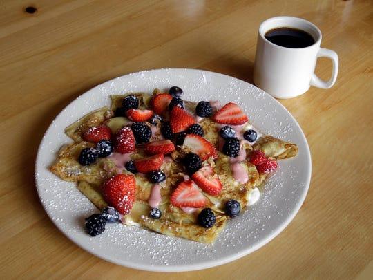 Fresh fruit blintzes  fill the plate at Mimosa Breakfast & Brunch, 9405 S. 27th St., Franklin.