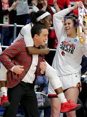 Louisville's Jazmine Jones jumps on Sam Purcell as