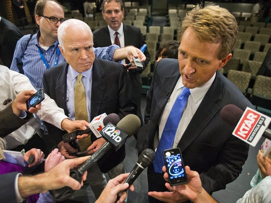 Sens. John McCain (left) and Jeff Flake answer questions