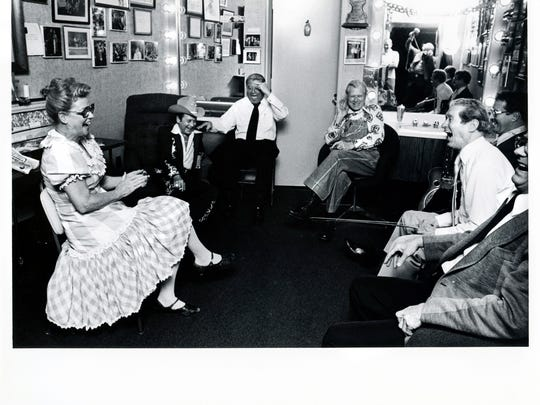 Minnie Pearl, from left, Little Jimmy Dickens, Howdy Forrester, Bashful Brother Oswald, Roy Acuff and Charlie Collins laugh in Acuff's dressing room March 1, 1980.