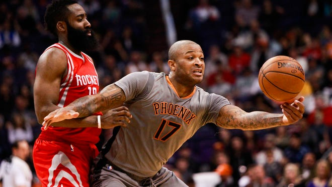 Phoenix Suns forward P.J. Tucker grabs the ball after a steal from Houston Rockets guard James Harden as the Phoenix Suns face off against the Houston Rockets on Thursday, Feb. 4, 2016, at Talking Stick Resort Arena in Phoenix, Ariz.
