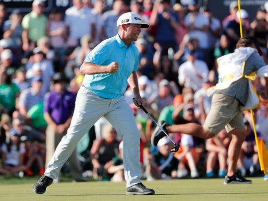 Chez Reavie reacts after sinking a birdie on the 18th