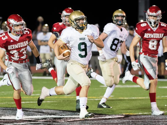 York Catholic's Kyle Dormer (9) takes off on a quarterback keep during play against Bermudian Springs on Friday, Oct. 20, 2017. York Catholic won 41-26.