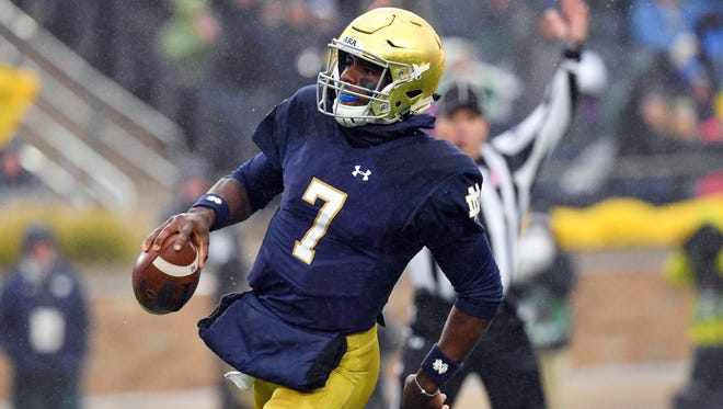 Nov 4, 2017; South Bend, IN, USA; Notre Dame Fighting Irish quarterback Brandon Wimbush (7) scores a touchdown in the second quarter against the Wake Forest Demon Deacons at Notre Dame Stadium. Mandatory Credit: Matt Cashore-USA TODAY Sports