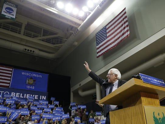 Democratic presidential candidate Bernie Sanders waves