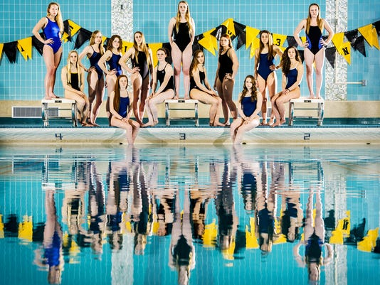 From left to right: Spring Grove's Emily Jenkins, Red Lion's Courtney Schaefer, West York's Maelyn Elder, West York diver Erika Sarver, West York's Taylor Hoover, York Suburban's Megan Hunt, York Suburban's Madie Devaney, York Suburban's Carson Gross, York Suburban's Anna Schmittle, York Suburban's Jenna Hufnagle, Dallastown's Anna Hess, Dallastown's Jena Woods, Dallastown's Erica Wise and New Oxford's Regan Chalk. GameTimePA's all-star swimmers. Picture taken Thursday, March 19, 2015, at Red Lion. Chris Dunn Ñ Daily Record/Sunday News