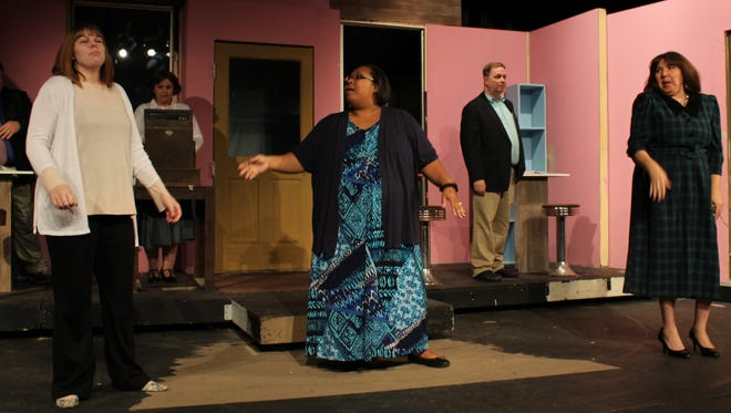 """Tosha Flores, a customer, center, is joined in a perfumery by (from left) a customer (Elizabeth Butcher), Ilona Ritter at the cash register (Kendr Brown), employee Ladislov Sipos (Tony Redman) and another customer (Sylvia Barone) in this rehearsal scene from """"She Loves Me,"""" an Abilene Community Theatre production that opens Thursday."""