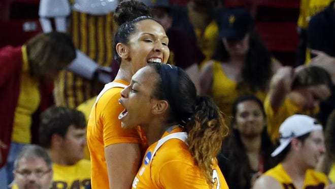 Tennessee center Mercedes Russell, left, and Tennessee forward Bashaara Graves celebrate their win over Arizona State on Sunday in Tempe, Ariz. Tennessee won 75-64.