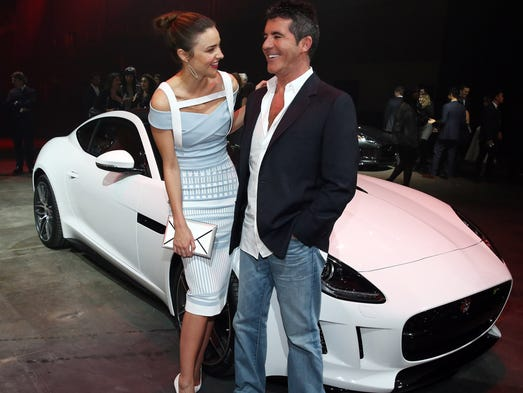 Miranda Kerr and Simon Cowell celebrate the global debut of the 2015 Jaguar F-Type R Coupe