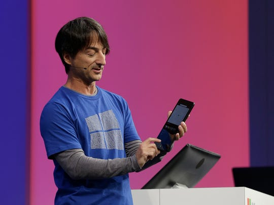 Microsoft Corporate Vice President of Operating Systems Group Joe Belfiore holds a tablet while speaking at the Microsoft Build conference in San Francisco, Wednesday, April 29, 2015. While Microsoft has already previewed some aspects of the new Windows 10, a parade of top executives will use the conference to demonstrate more software features and app-building tools, with an emphasis on mobile devices as well as PCs. (AP Photo/Jeff Chiu)