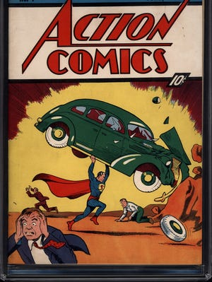 A copy of the 1938 edition of Action Comics No. 1, featuring Superman's debut, is shown.