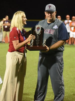 Tallahassee manager Mike Harrison accepts the runner-up trophy.