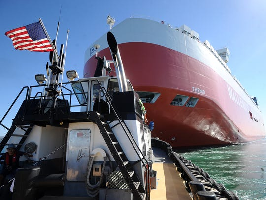 The tugboat Tulipan, captained by Jeff Guilliams, helps the the Themis, a Wallenius Wilhelmsen cargo ship, dock at the Port of Hueneme.