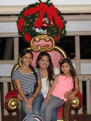 Lauren Cruz, Angelina Cruz and Gabriella Cruz attend the Peace Festival at the Government House in 2014.