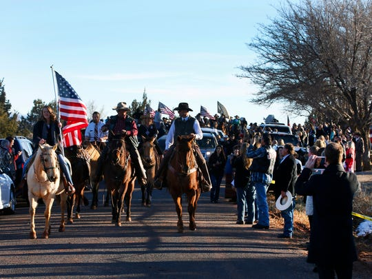 "People line the road as a horse honor guard escorts the hurst after the funeral of rancher Robert ""LaVoy"" Finicum on Feb. 5, 2016 in Kanab, Utah."