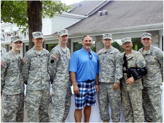 Dr. Glen Mesaros, center, hosted a Swing for the Troops Golf Tournament on May 18 at the Lebanon County Club to support the Wounded Warrior Project and PA Wounded Warriors Inc. With a 100 golfers, the tournament raised over $12,000. With Mesaros are six soldiers from Fort Indiantown Gap. Submitted